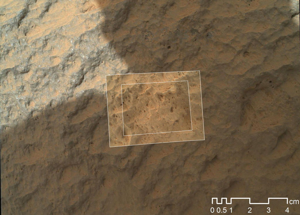 This image combines photographs taken by the Mars Hand Lens Imager (MAHLI) at three different distances from the first Martian rock that NASA's Curiosity rover touched with its arm.