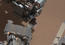 see the image 'View of Curiosity's First Scoop Also Shows Bright Object'