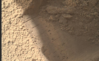 see the image 'Bright Particle of Martian Origin in Scoop Hole'