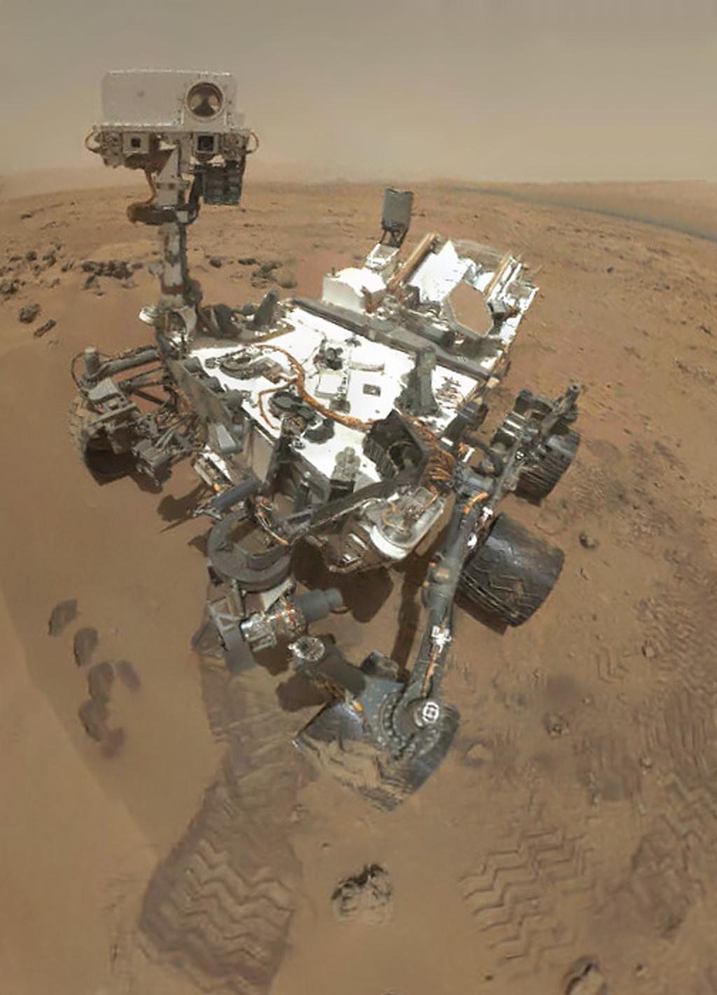 Self-portrait of NASA's Curiosity Mars rover uses thumbnail versions of MAHLI component images to give an idea of what a sharper version will look like when the full-frame images are assembled.