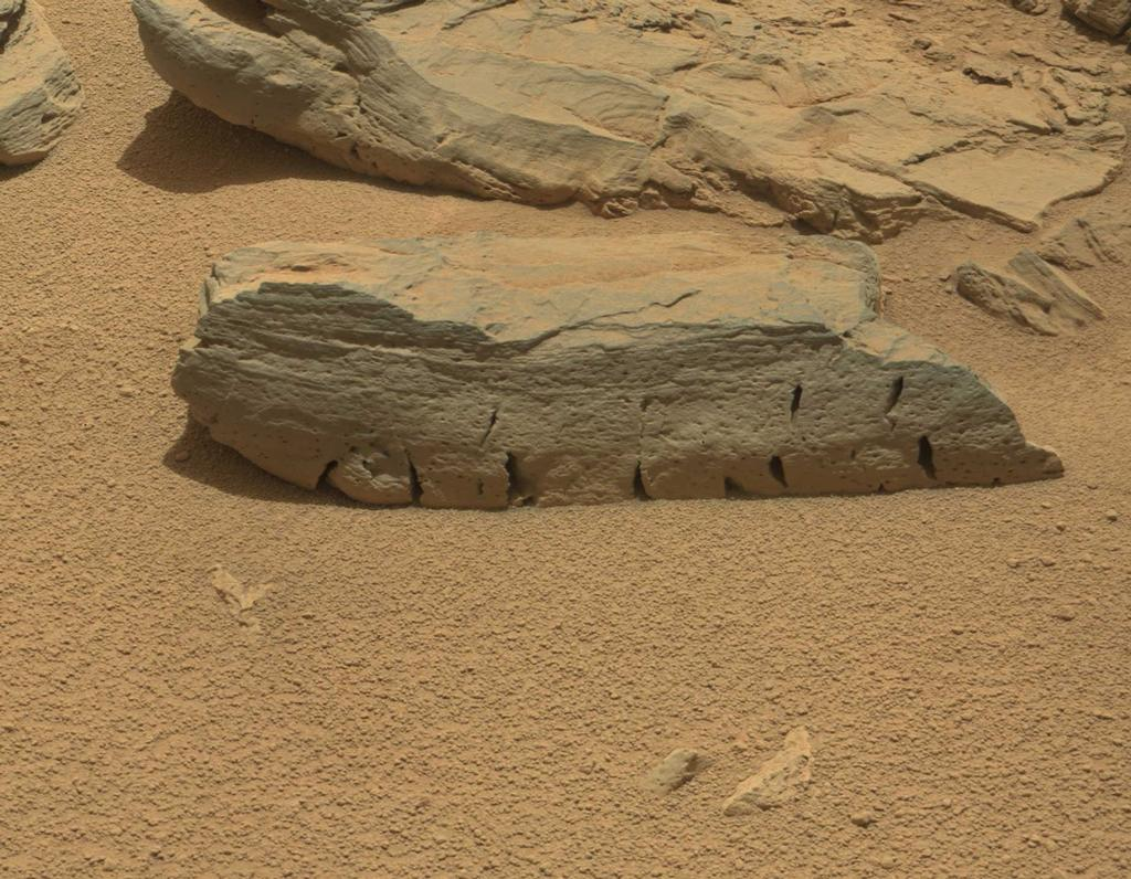 "This view of a Martian rock called ""Rocknest 3"" combines four images taken by the right-eye camera of the Mast Camera (Mastcam) instrument, which has a telephoto, 100-millimeter-focal-length lens."