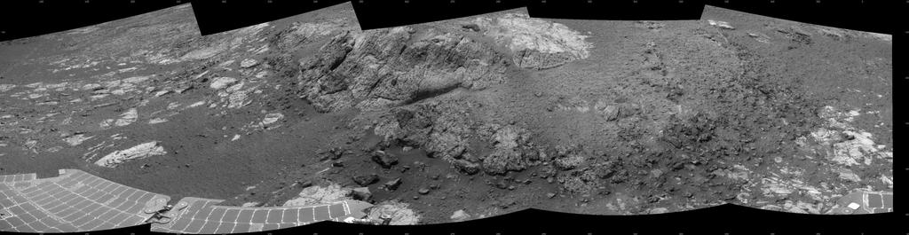 This 180-degree mosaic of images from the navigation camera on the NASA Mars Exploration Rover Opportunity shows terrain near the rover during the 3,153rd Martian day, or sol, of the rover's work on Mars (Dec. 6, 2012).