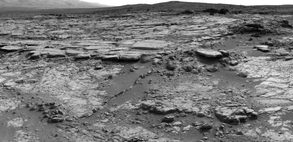 "The sinuous rock feature in the lower center of this mosaic of images recorded by the NASA Mars rover Curiosity is called ""Snake River."""