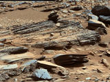 "This image from the Mast Camera (Mastcam) on NASA's Mars rover Curiosity shows inclined layering known as cross-bedding in an outcrop called ""Shaler"" on a scale of a few tenths of meters, or decimeters (1 decimeter is nearly 4 inches)."