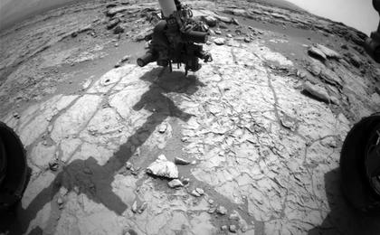 see the image 'Curiosity's Drill in Place for Load Testing Before Drilling'