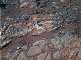 "This image from the panoramic camera (Pancam) on NASA's Mars Exploration Rover Opportunity shows a pale rock called ""Esperence,"" which was inspected by the rover in May 2013."