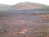 "Opportunity used its panoramic camera (Pancam) to acquire this view of ""Solander Poin."" The southward-looking scene, presented in false color, shows Solander Point on the center horizon, ""Botany Bay"" in the foreground, and ""Cape Tribulation"" in the far background at left."