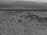 "NASA's Mars Exploration Rover Opportunity used its panoramic camera (Pancam) to record this view of the rise in the foreground, called ""Nobbys Head."""