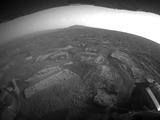 "This view shows the terrain that NASA's Mars Exploration Rover Opportunity is crossing in a flat area called ""Botany Bay"" on the way toward ""Solander Point,"" which is visible on the horizon."