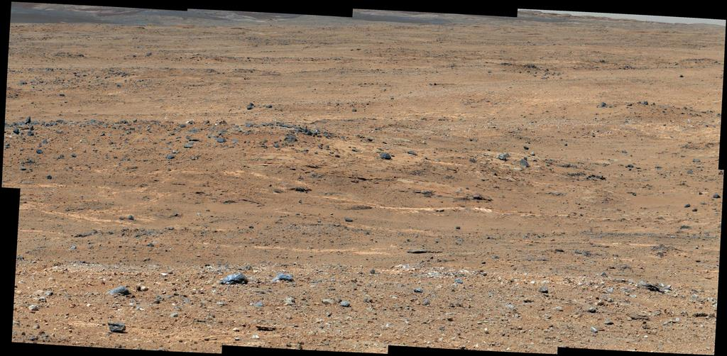 An outcrop visible as light-toned streaks in the lower center of this image has been chosen as a place for NASA's Mars rover Curiosity to study for a few days in September 2013.