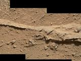 read the article 'NASA Rover Inspects Pebbly Rocks at Martian Waypoint'