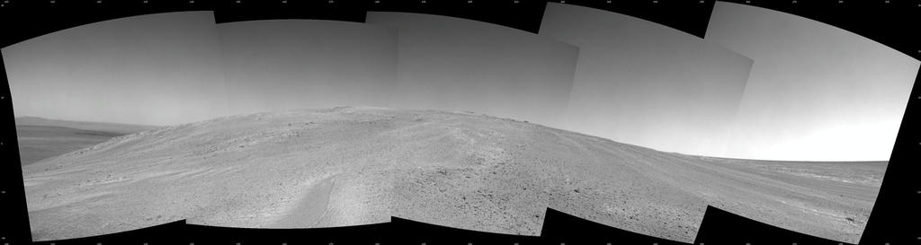 "NASA's Mars Exploration Rover Opportunity captured this southward uphill view after beginning to ascend the northwestern slope of ""Solander Point"" on the western rim of Endeavour Crater."