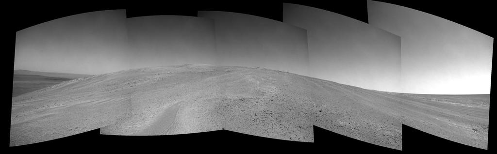 "NASA's Mars Exploration Rover Opportunity captured this view after beginning to ascend the northwestern slope of ""Solander Point"" on the western rim of Endeavour Crater."