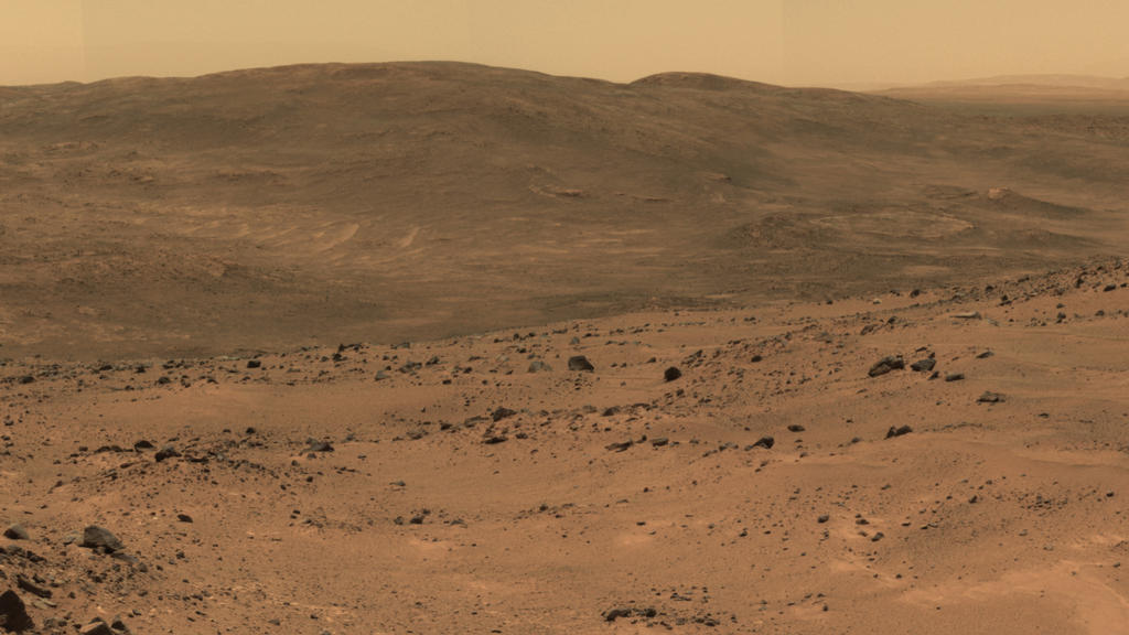 "This section from a panorama that NASA's Mars Exploration Rover Spirit acquired in October 2005 from the top of ""Husband Hill"" presents the view toward the south from that summit."