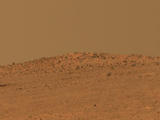 "The boulder-studded ridge in this scene recorded by NASA's Mars Exploration Rover Opportunity is ""McClure-Beverlin Escarpment,"" informally named for Jack Beverlin and Bill McClure, engineers who on Feb. 14, 1969, risked their lives to save NASA's second successful Mars mission, Mariner 6, on its launch pad."