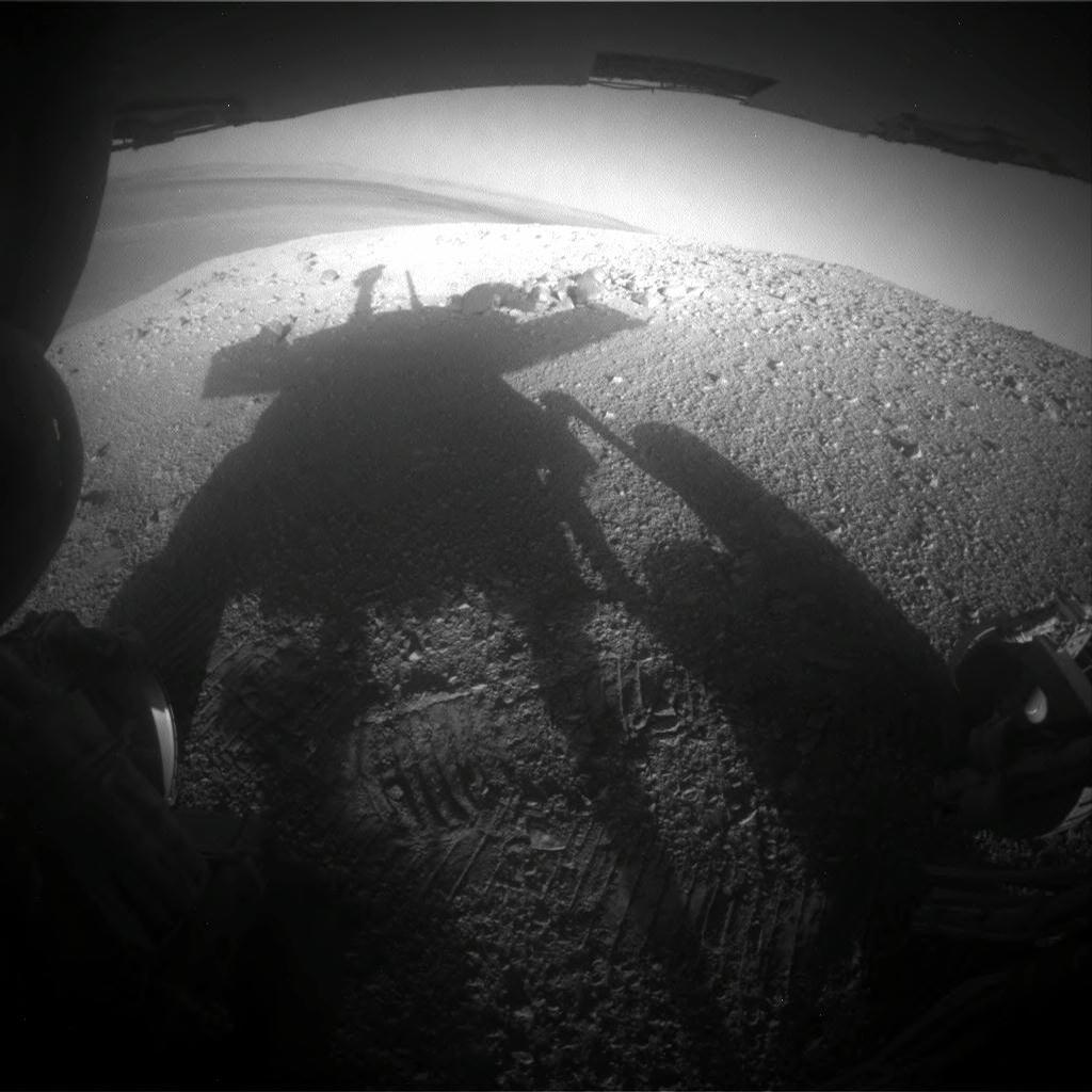 NASA's Mars Exploration Rover Opportunity caught its own silhouette in this late-afternoon image taken by the rover's rear hazard avoidance camera on March 20, 2014.