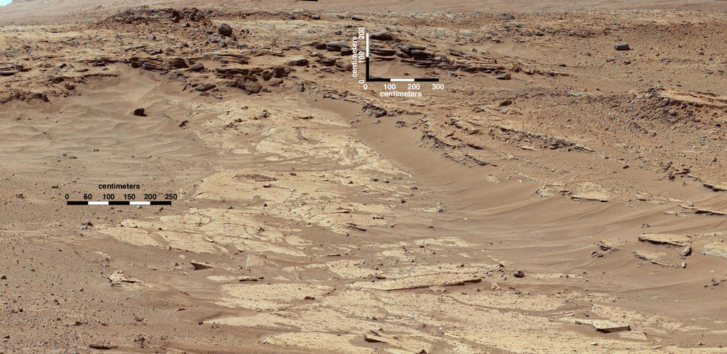 "Sandstone layers with varying resistance to erosion are evident in this Martian scene recorded by the Mast Camera on NASA's Curiosity Mars rover on Feb. 25, 2004, about one-quarter mile (about 400 meters) from a planned waypoint called ""the Kimberley."""