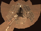 A self-portrait shows a view of the rover solar panels, which appear brown and dusty from overhead.