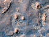 read the article 'NASA Mars Orbiter Spies Rover Near Martian Butte'