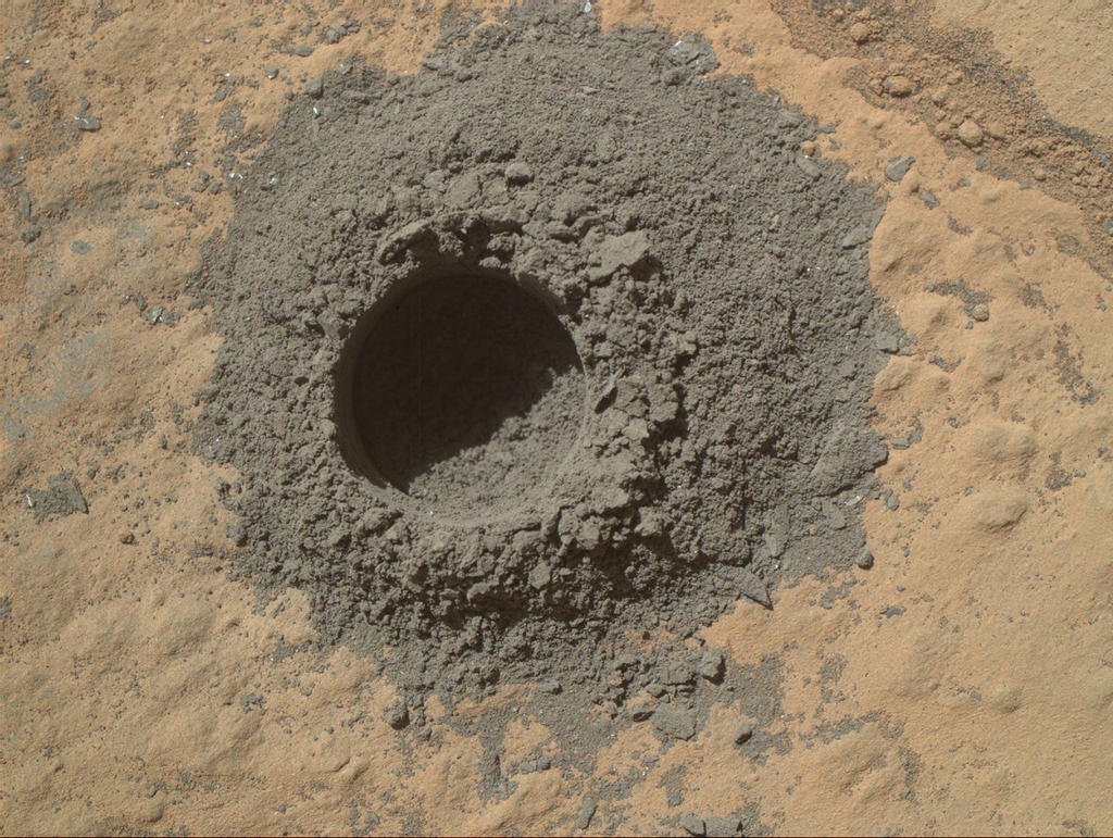 This image from Curiosity's Mars Hand Lens Imager shows the hole resulting from the test, 0.63 inch across and about 0.8 inch deep.
