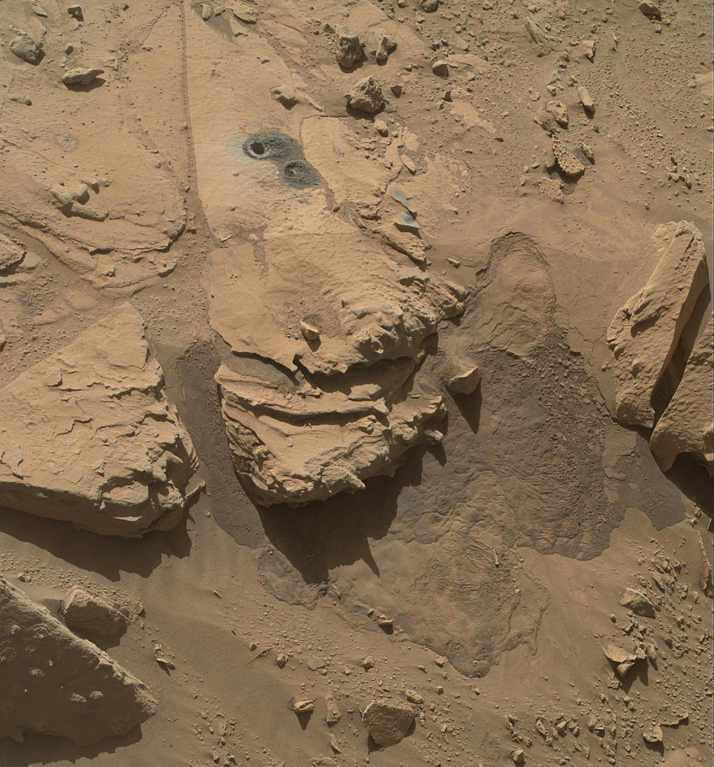 "This May 12, 2014, view from the Mars Hand Lens Imager (MAHLI) in NASA's Curiosity Mars Rover shows the rock target ""Windjana"" and its immediate surroundings after inspection of the site by the rover by drilling and other activities."