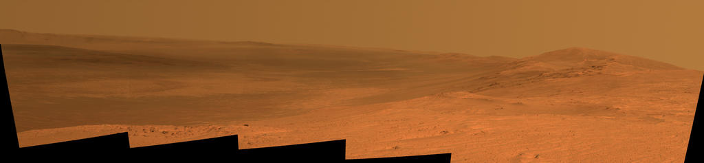 "This vista of the Endeavour Crater rim was acquired by NASA's Mars Exploration Rover Opportunity's panoramic camera on April 18, 2014, from the southern end of ""Murray Ridge"" on the western rim of the crater. In mid-May, the rover approached the dark outcrops on the flank of the hill at right."