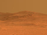 read the article 'NASA Rover Gains Martian Vista From Ridgeline'