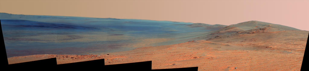 "This vista of the Endeavour Crater rim was acquired by NASA's Mars Exploration Rover Opportunity's panoramic camera on April 18, 2014, from ""Murray Ridge"" on the western rim of the crater. It is presented in false color to make differences in surface materials more easily visible."