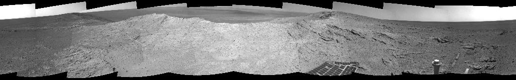 NASA's Mars Exploration Rover Opportunity used its navigation camera on May 10, 2014, to capture this 360-degree view near the ridgeline of Endeavour Crater's western rim. The center is southeastward. Rocks on the slope to the right of center are in an outcrop area targeted for the rover to study.