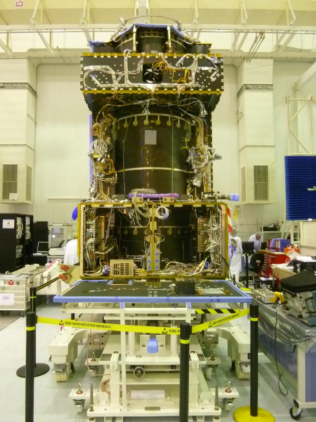 This June 2014 image from the clean room at Thales Alenia Space, in Cannes, France, shows ongoing assembly of the European Space Agency's ExoMars Trace Gas Orbiter, including the first of the orbiter's two Electra UHF relay radios provided by NASA.