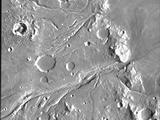 The channel system in the upper half of the image is Maja Valles. The channels appear to have been carved by flowing water released from Juventae Chasma a chaotic depression that is located several hundred kilometers to the south.