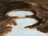 read the article 'NASA Space Craft Detects Buried Glaciers on Mars'