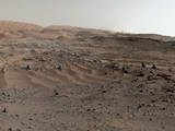 A panorama combining images from both cameras of the Mastcam on NASA's Curiosity Mars Rover shows diverse geological textures on Mount Sharp. Three years after landing on Mars, the mission is investigating this layered mountain for evidence about changes in Martian environmental conditions.