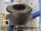 The heat shield is suspended above the rest of the InSight spacecraft in this image taken July 13, 2015, in a spacecraft assembly clean room at Lockheed Martin Space Systems, Denver.