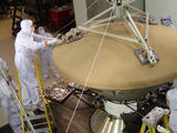 Spacecraft specialists at Lockheed Martin Space Systems, Denver, prepare NASA's InSight spacecraft for vibration testing as part of assuring that it is ready for the rigors of launch from Earth and flight to Mars.