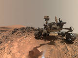 "This low-angle self-portrait of NASA's Curiosity Mars rover shows the vehicle at the site from which it reached down to drill into a rock target called ""Buckskin."" The MAHLI camera on Curiosity's robotic arm took multiple images on Aug. 5, 2015, that were stitched together into this selfie."