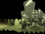 This view of a test rover at NASA's Jet Propulsion Laboratory in California results from advance testing of arm positions and camera pointings for taking a low-angle selfie of NASA's Curiosity Mars rover. The rehearsal led to a dramatic Aug. 5, 2013, selfie of Curiosity by the rover's MAHLI camera.
