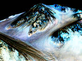 read the article 'NASA Confirms Evidence That Liquid Water Flows on Today's Mars'