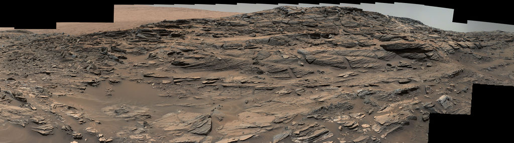 Large-scale crossbedding in the sandstone of this ridge on a lower slope of Mars' Mount Sharp is typical of windblown sand dunes that have petrified. NASA's Curiosity Mars rover used its Mastcam to capture this vista on Aug. 27, 2015. Similarly textured sandstone is common in the U.S. Southwest.