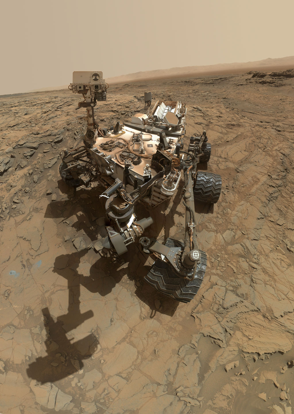 "This self-portrait of NASA's Curiosity Mars rover shows the vehicle at the ""Big Sky"" site, where its drill collected the mission's fifth taste of Mount Sharp. It was taken on Oct. 6, 2015, PDT."