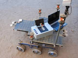 Researchers took the Chemical Laptop to JPL's Mars Yard, where they placed the device on a test rover. This image shows the size comparison between the Chemical Laptop and a regular laptop.