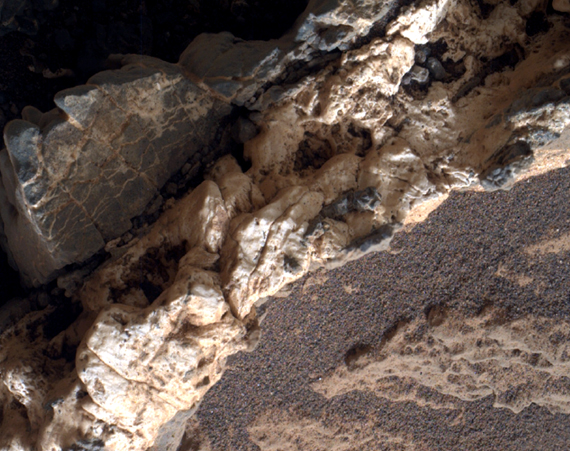 "This view from the Mars Hand Lens Imager (MAHLI) on the arm of NASA's Curiosity Mars rover shows a combination of dark and light material within a mineral vein at a site called ""Garden City"" on lower Mount Sharp. The image was taken on April 4, 2015, and covers an area roughly 1 inch wide."