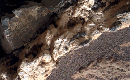 see the image 'Light Material Ripped Up Older Dark Vein Material'