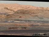 "The dark band in the lower portion of this Martian scene is part of the ""Bagnold Dunes"" dune field lining the northwestern edge of Mount Sharp. The scene combines multiple images taken with the Mast Camera on NASA's Curiosity Mars rover on Sept. 25, 2015. The view is toward south-southeast."