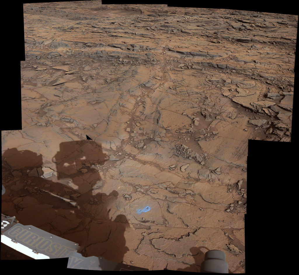"This view from the Mast Camera (Mastcam) on NASA's Curiosity Mars rover covers an area in ""Bridger Basin"" that includes the locations where the rover drilled a target called ""Big Sky"" on the mission's Sol 1119 (Sept. 29, 2015) and a target called ""Greenhorn"" on Sol 1137 (Oct. 18, 2015)."