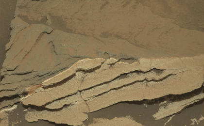 read the article 'Detail of Discoloration Pattern Seen by Curiosity'