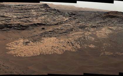 read the article 'Rocks Rich in Silica Present Puzzles for Mars Rover Team'