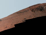 "This scene from NASA's Mars Exploration Rover Opportunity looks upward at ""Knudsen Ridge"" on the southern edge of ""Marathon Valley"" from inside the valley."