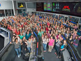 Women working in science, technology, engineering and mathematics at NASA's Jet Propulsion Laboratory pose for a photo in mission control in honor of Women in Science Day.
