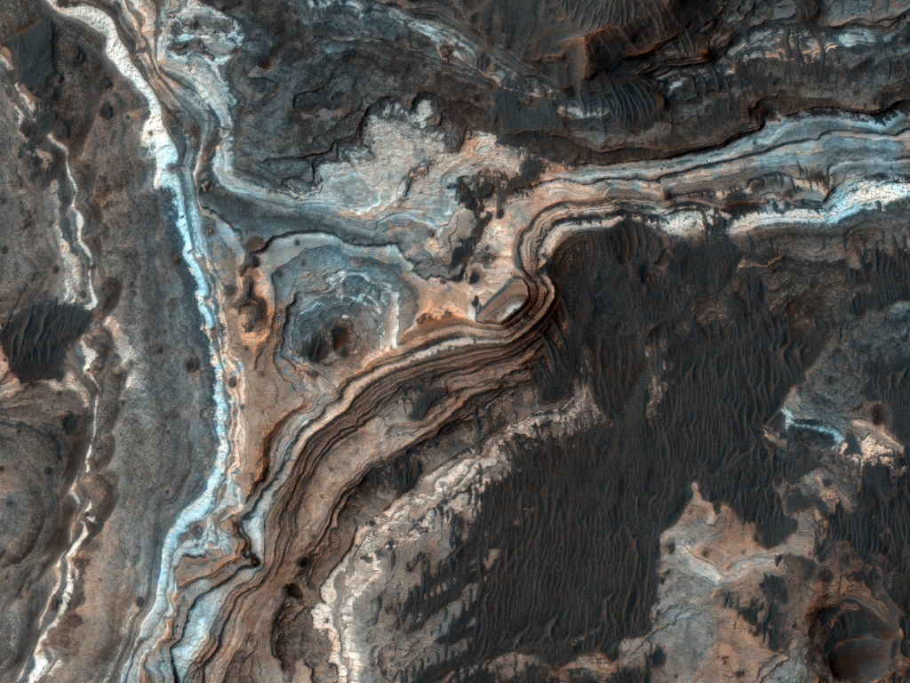 This image shows part of Ladon Vallis, a long outflow channel found in the Southern Highlands on Mars.